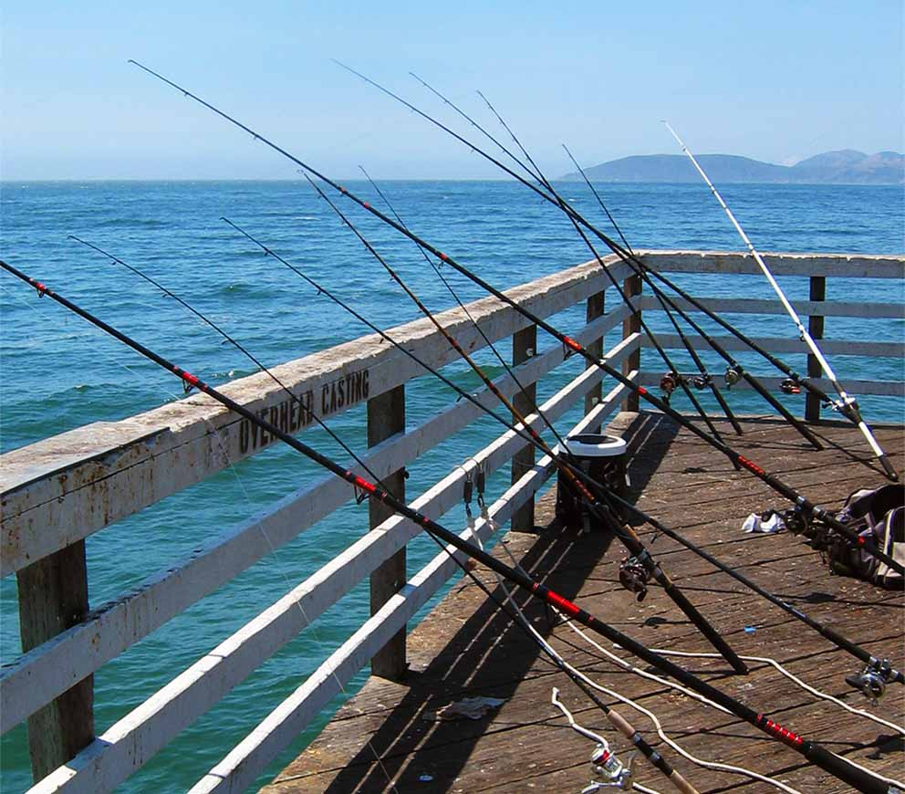 fishing poles on the pier at pismo beach